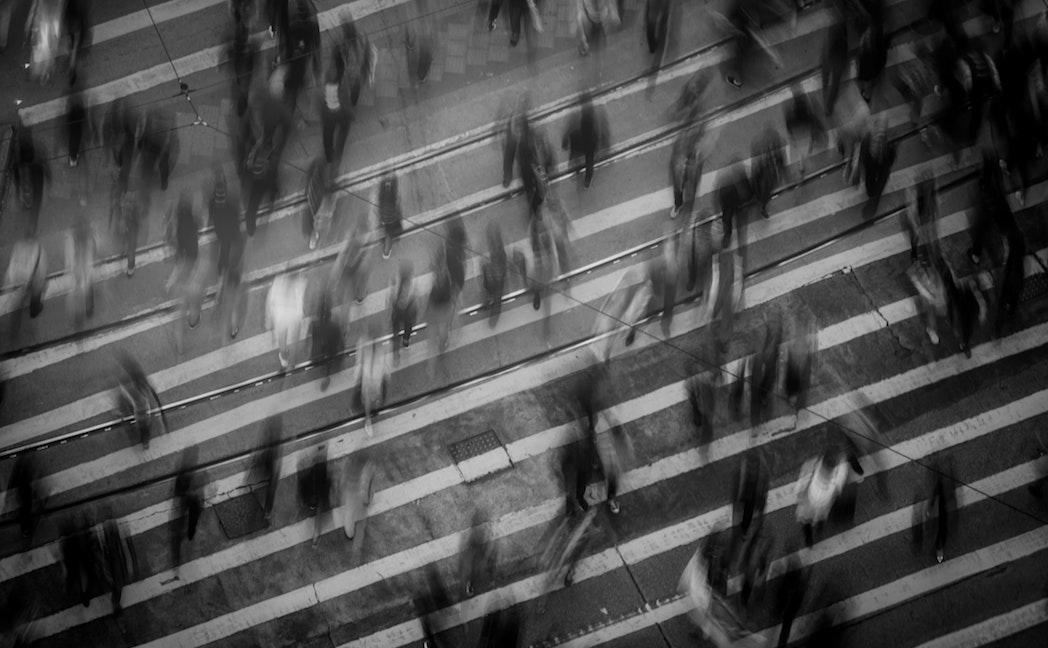 people crossing city road